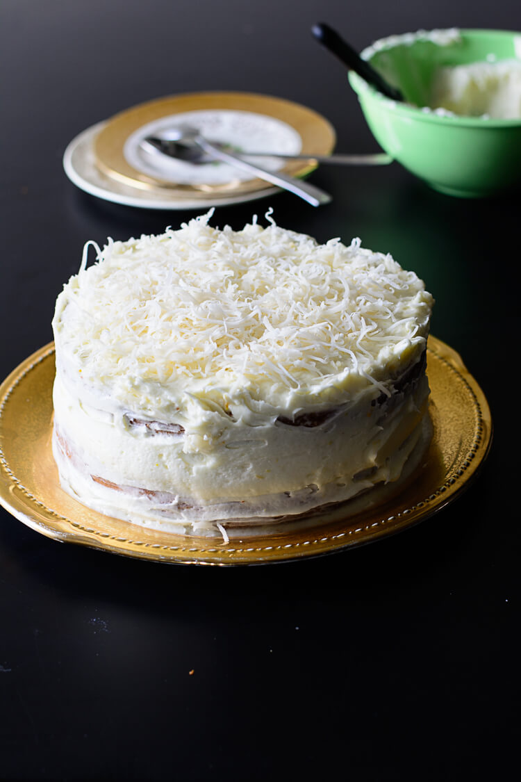 Full and iced cake on a table ready for serving
