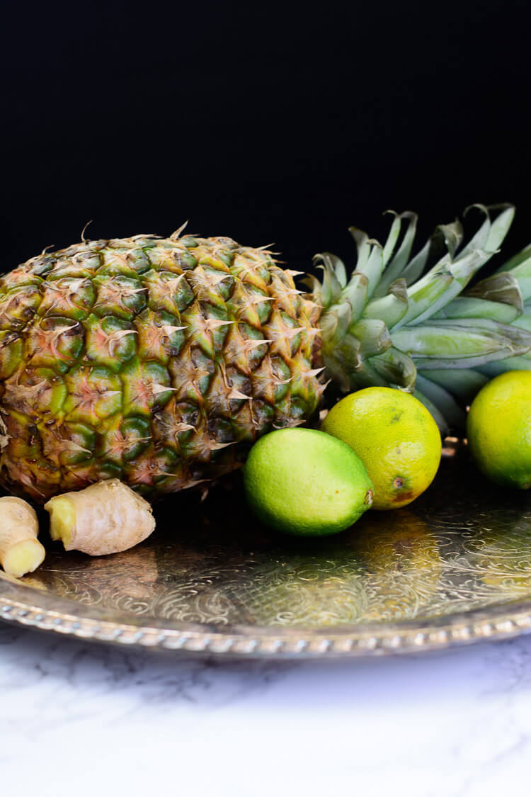Pineapple Ginger Juice: Healthy homemade - a tray with pineapple, lime and ginger