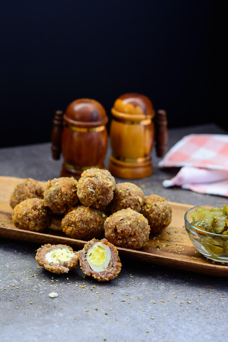 Quail Egg Scotch Eggs with homemade sausage - laid out with pickles on the side