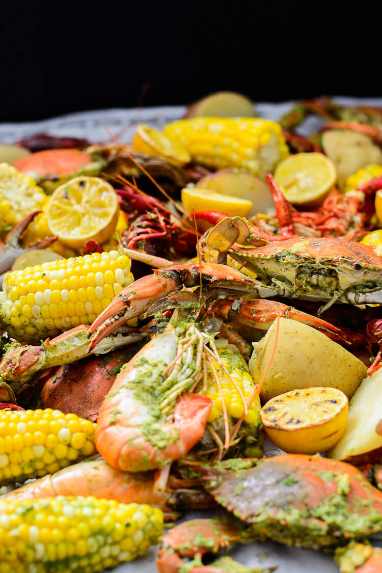 Best Summer Seafood Boil with Homemade Seasoning - Close up picture of boil laid out on paper