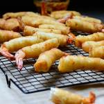 "Crunchy Shrimp Roll (Firecracker Shrimp) - Firecracker shrimp is a fun, delicious and crunchy shrimp roll that's commonly served as an appetizer or ""small chops"" in weddings and parties"