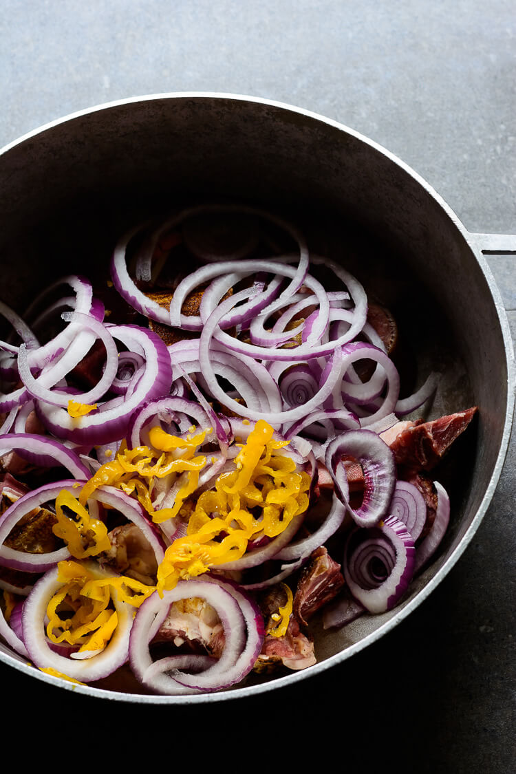 onions, pepper and meats in the pot