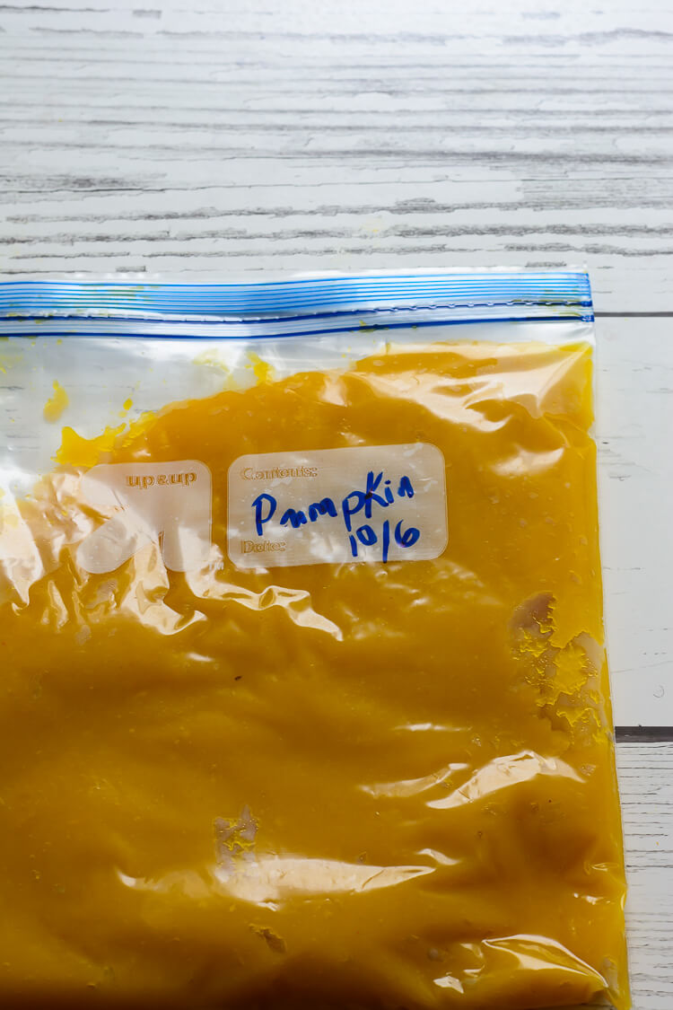 Homemade Pumpkin Puree from Scratch - pumpkin puree stored in a plastic ziploc bag ready for freezing