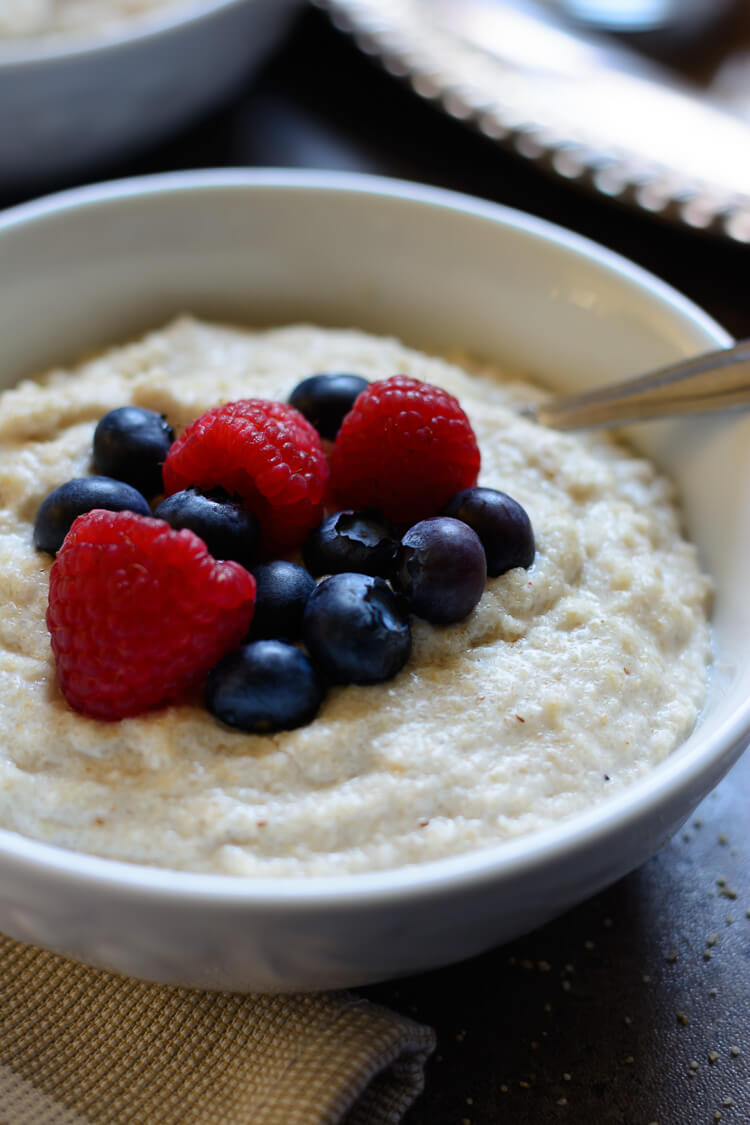 Fonio Porridge served in a bowl with berry toppings