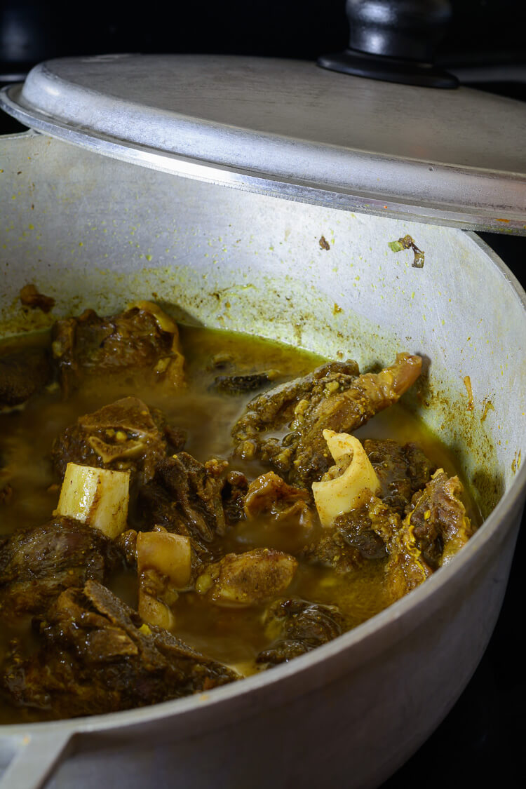 Jamaican curried goat in pot after cooking
