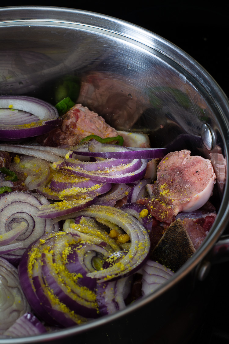 How to Braise Meat Properly - onions, green peppers and seasoning added to meat in the pot