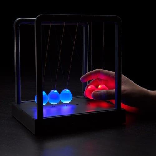 Illuminating Newton's Cradle