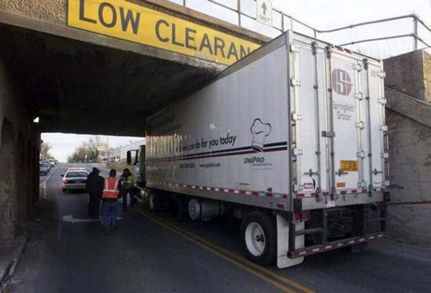 Truck Hitting Low Clearance Sign