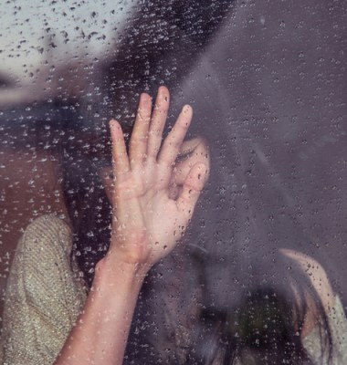 Hand on window pane