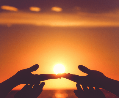 Hands touching during sunset