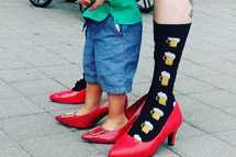 kid and adult with red shoes