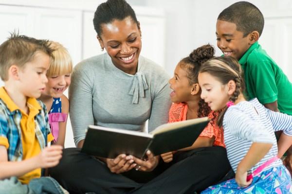 A Child Reading to Preschool Teachers