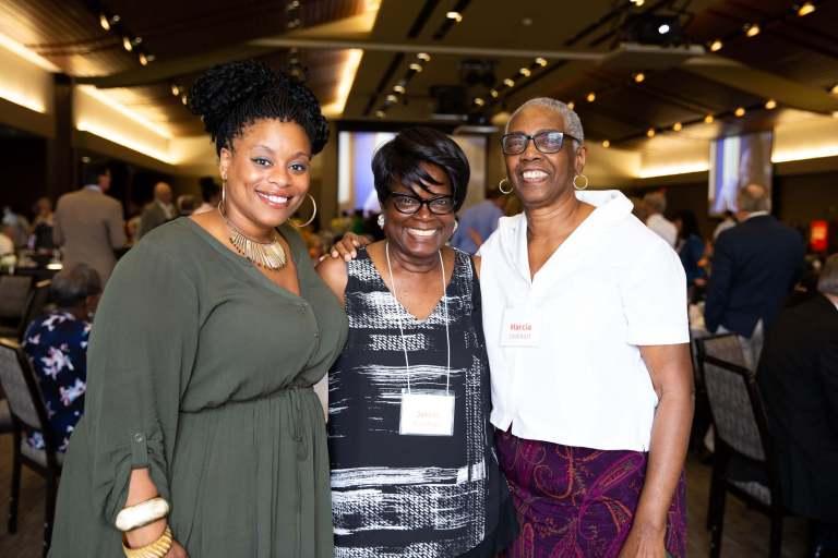 Three women at Sweet Success smiling at camera