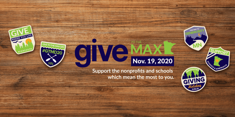 Give to the Max Day logo on wooden background