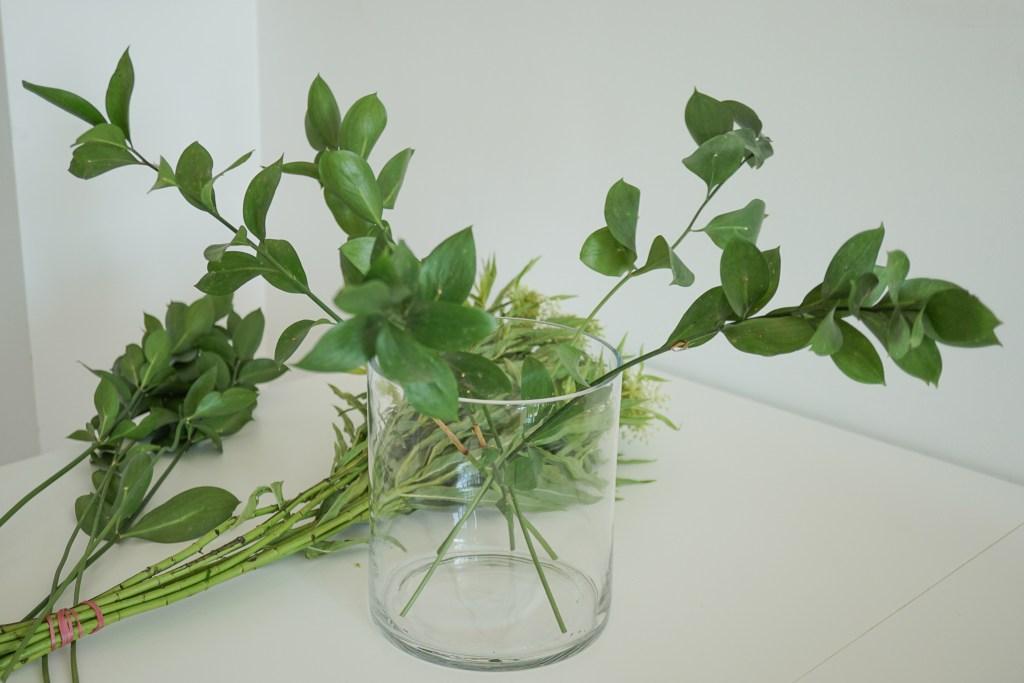 Green filler leaves in vase