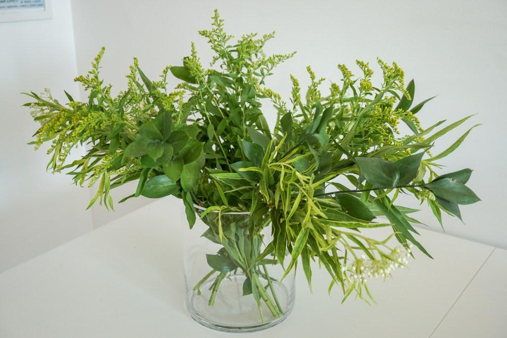 Adding yellow flowers to vase