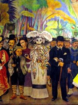 """Imagen del mural """"Sueño de una tarde dominical en la Alameda Central"""", realizado por Diego Rivera. El niño a la derecha de La Catrina es Diego Rivera; detrás de él se puede ver a Frida Kahlo; a la izquierda, con bastón, José Guadalupe Posada."""