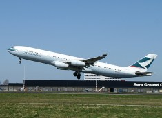 Cathay Pacific Airbus A340-313X, B-HXJ in take-of from Schiphol Amsterdam Airport.