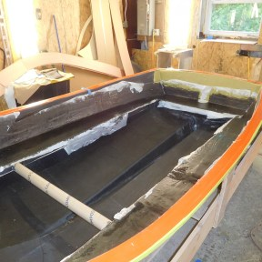 Seat rails tabbed in while hull is still stable in the mold.