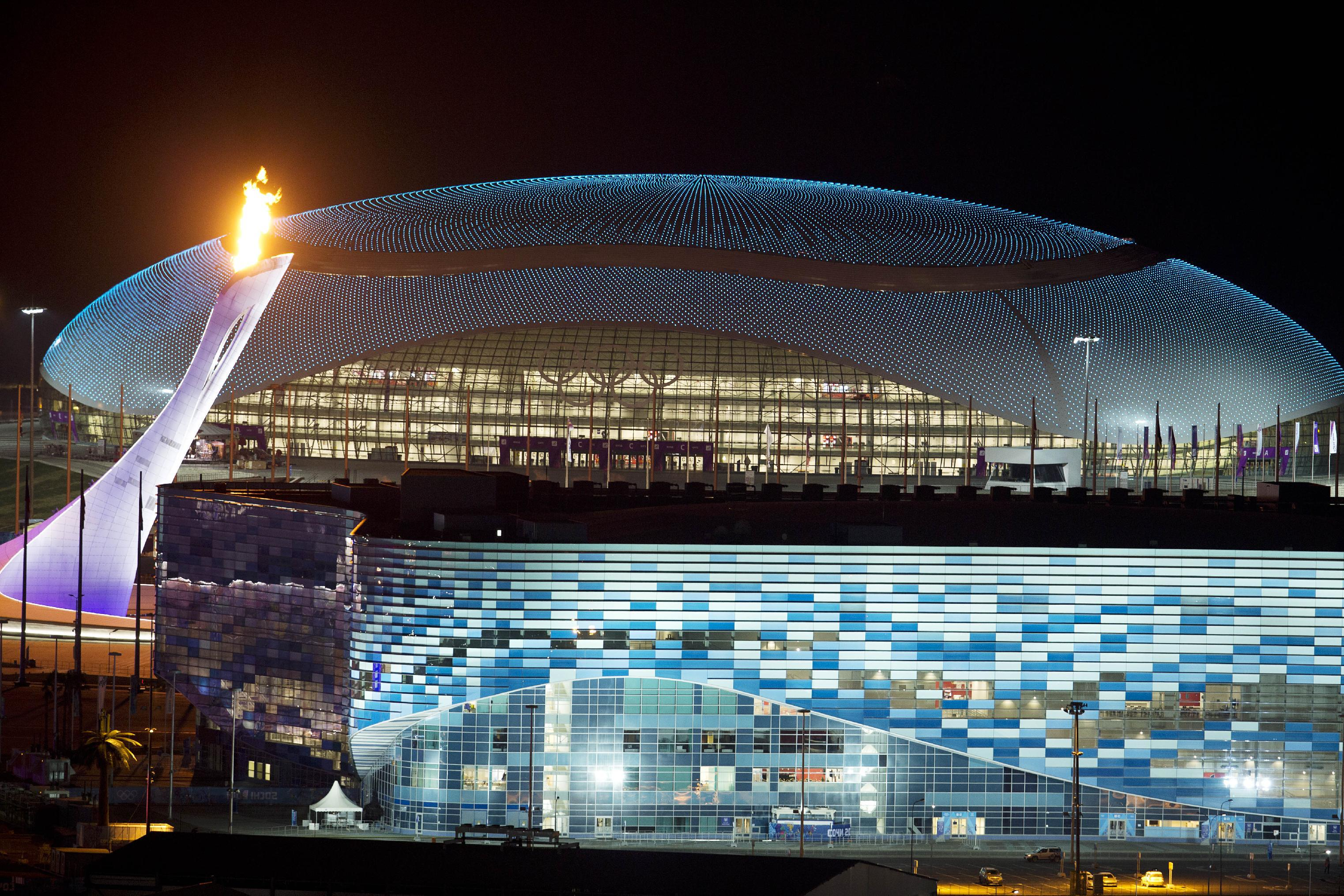 Olympic Torch On A Background Of The Stadium At The