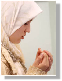 Young Muslim woman making dua