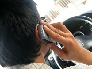 man talking on cell phone while driving, cell phone