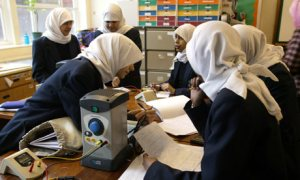Science class at an Islamic school for girls, time to study,