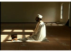 Muslim man sitting in prayer