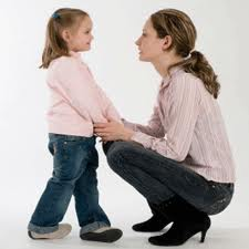 disciplining a child, mother and daughter