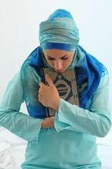 muslim woman holding onto quran