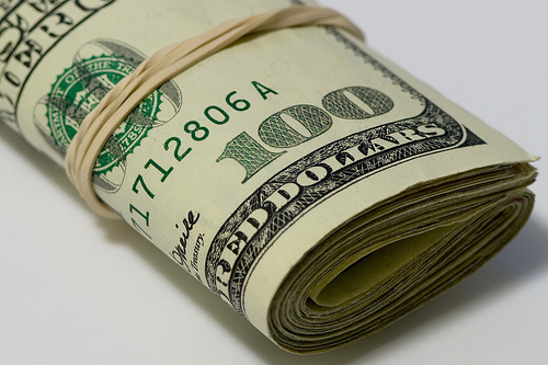 Money roll, dollar bills, cash