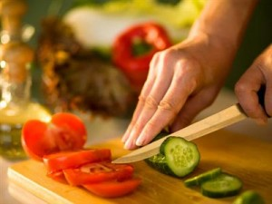 Woman's hand with cooking knife