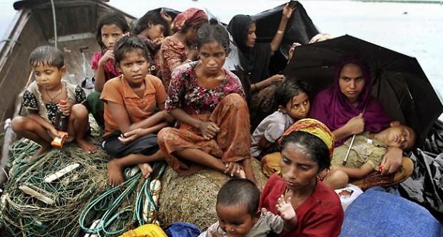 Rohingya Muslim refugees flee Burma (Myanmar) on a boat.