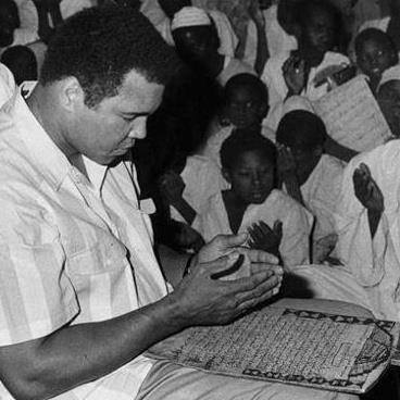 Muhammad Ali praying