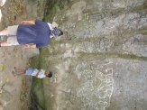 "Wael looking at ""La Piedra Pintada"", a rock in Panama carved with pre-Columbian petroglyphs"