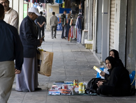 Iraqi refugees selling goods on the street.