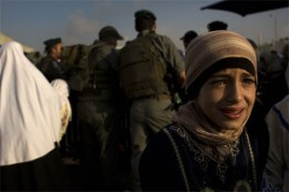 Palestinian girl cries at a checkpoint