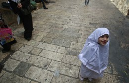 Palestinian girl going with her family to Al-Aqsa
