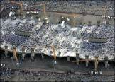"Millions of pilgrims participated in the ritual ""jamra"" or ""stoning of the Devil"", represented by three stone pillars."