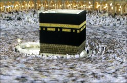Tens of thousands of Muslim pilgrims move around the Kaaba, the black cube seen at center, inside the Grand Mosque, during the annual Hajj in Mecca, Saudi Arabia, Monday, Dec. 8. AP / Hassan Ammar