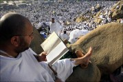 A Muslim pilgrim reads the koran at Mount Arafat, southeast of the Saudi holy city of Mecca, on Dec. 7. A human tide washed over Mount Arafat today morning as hundreds of thousands of devoted Muslims gathered for the key moment of the annual hajj pilgrimage to Saudi Arabia. AFP / Getty Images / Khaled Desouki