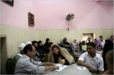 At a mosque in Cairo, Amal Muhammad Hassan, 17, center, signs a marriage contract alongside her fiancé, Yasser Allam, 27, right, with the mazoun, an Islamic marriage official who acquires the signatures, registers documents and performs other tasks related to marriage.