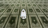 A Palestinian Muslim girl prays