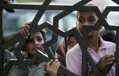 Jordanian Muslim girls queue in line outside a humanitarian center for waiting for meals to be donated at the time for the breaking of their fast, or Iftar, on the 13th day of the Muslim holy fasting month of Ramadan in Amman, Jordan, Saturday, Sept. 13, 2008. (AP Photo/Nader Daoud) #