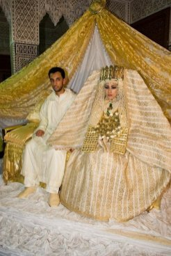 a traditional wedding dress with gold jewelry