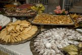 The wedding guests are treated to a multitude of sweet cakes, mint tea and fruit juice.