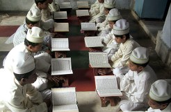 Mathura, India: Young boys read the Quran at a madrasa, or religious school, during Ramadan.