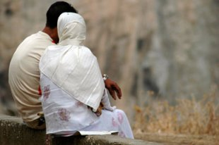 Muslim couple sitting close together
