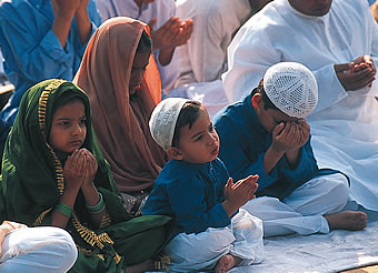 Muslim family at Eid prayer