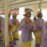 Kompang musicians playing Malay hand drums